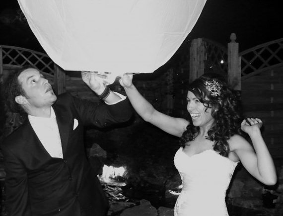Bride & Groom Release a Wish Lantern at a Wedding Reception