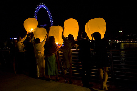 Guests release Wedding Wish Lanterns at a Wedding Reception