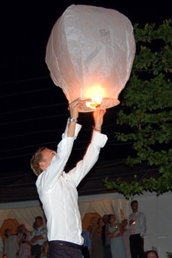 A guest releases a Wedding Wish Lantern at a Wedding Reception